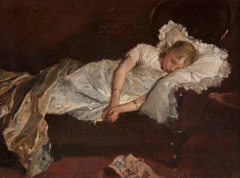 Jovem a dormir no sofá